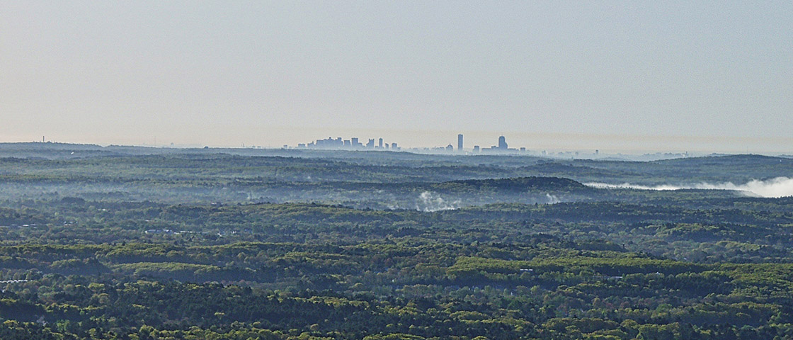 Boston Skyline as seen from launch in Stow, MA